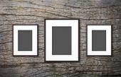 Blank photo frame on old wood background — Stock Photo