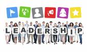 People Holding Letters Form Leadership — Stock Photo