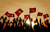 People Waving Vietnamese Flags — Stock Photo