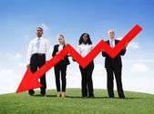 Business people Holding Declining Line Graph — Stock Photo