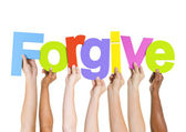 People Holding Letters Forgive — Stock Photo