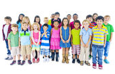 Group of children standing in line — Stock Photo