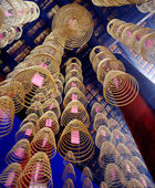 Incense coils burning in Chinese temple — Stock Photo