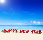 Happy New Year words on beach — Stock Photo
