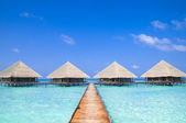 Dock at Maldives with clear water — Stock Photo