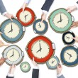Business People's Hands Holding Clocks — Stock Photo #52451035