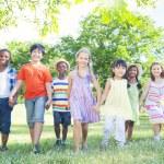 Children walking In Park — Stock Photo #52452401