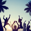 Young People Celebrating on a Beach — Stock Photo #52454895