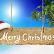 Christmas board on beach — Stock Photo #52455149