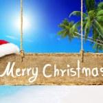 Christmas board on beach — Stock Photo #52455149