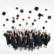 Graduation Caps Thrown in the Air — Stock Photo #52455629