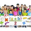 Diverse Cheerful Children Holding Mathematical Symbols — Stock Photo #52457659