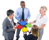 Business people building jigsaw — Stock Photo