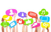 Hands holding speech bubbles icons — Stock Photo
