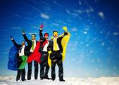 Business Superheros with arms raised — Stock Photo
