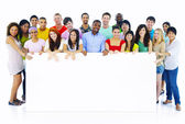 Large Group of People Holding Board — Stock Photo