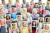 People with tablets in front of faces — Stock Photo