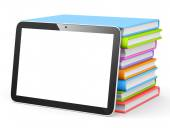 Tablet with stack of books — Stock Photo