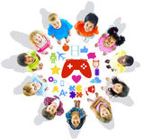 Group of Children Looking Up with Gaming Symbols — Stock Photo