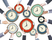Business People's Hands Holding Clocks — Stock Photo