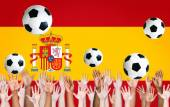 Raised Arms and Spanish Flag — Stock Photo