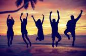 People Jumping with Excitement on the Beach — Foto Stock