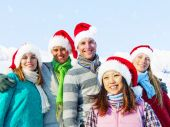 Group of friends in snow — Stock Photo
