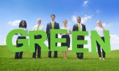 Business People holding word Green — Stock Photo