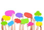 Hands holding speech bubbles — Stock Photo
