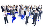 Multi-ethnic group of business people with world map — Stock Photo