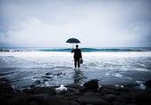 Businessman facing storm — Stock Photo