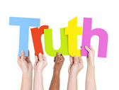 Arms Holding word Truth — Stock Photo