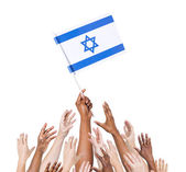 Arms Raised for Flag of Israel — Stock Photo