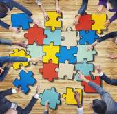 Business People Forming Jigsaw Puzzle — Stock Photo
