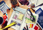 Messy Designer's Table with Project Plan and Tools — Stock Photo