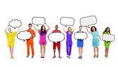 People Holding Blank Speech Bubbles — Stock Photo