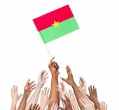 People Holding Flag Of Burkina Faso — Stock fotografie