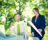 Business people holding wind turbine — Stock Photo