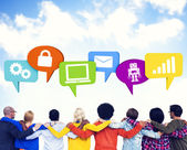 Crowd and speech bubbles containing symbols — Stock Photo