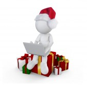 Santa boy with gift playing game — Stock Photo