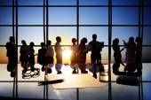 Silhouettes of Business People Working in Board Room — Stock Photo