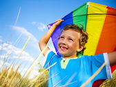 Boy Playing Kite Outdoors — Стоковое фото