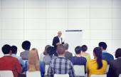 Businessman Presenting in Front of Audience — Stock Photo