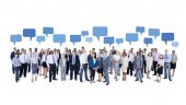 Mullti-ethnic group of business person with blue chat box — Stockfoto