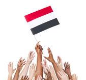Human hand holding Yemen flag — Stock Photo