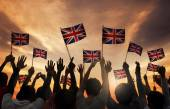 People Holding National Flag of UK — Stock Photo