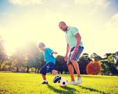 Boy playing soccer with father — Stock Photo