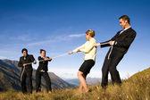 Business people playing tug — Stock Photo