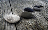 Pebbles on an Old Wooden Pier — Stock Photo