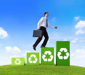 Businessman on stairs with Recycling Symbol — Stock Photo